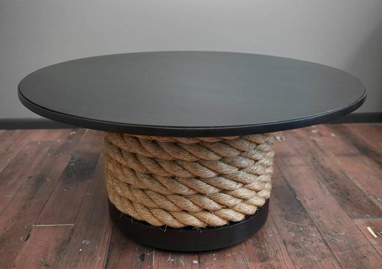 The Steel and Rope Coffee Table is a strong, well crafted piece of furniture. It glides easily across the floor on hidden castors, despite it's heavy weight. The two inch nautical rope circles and dives in and out of the base creating a seamless