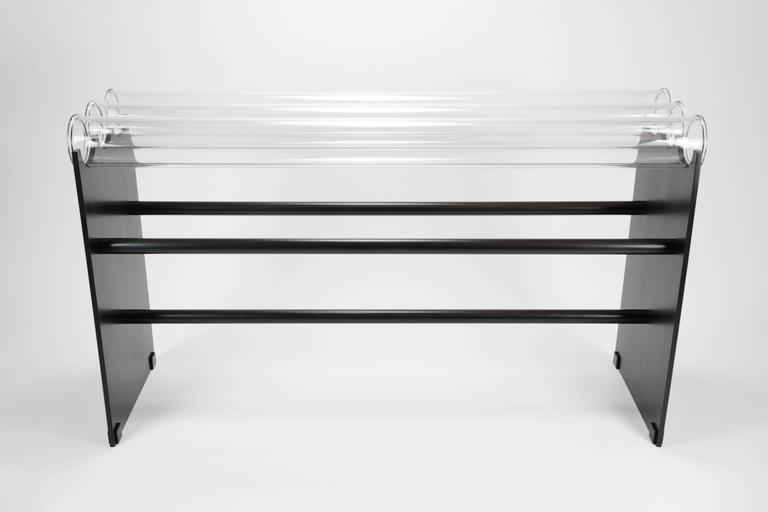 The Museum console was inspired by the Museum bench (see separate listing) It's made of glass pipes, solid steel, and is strong enough to hold up to 250 pounds!  The steel has a blackened patina that reads as a dark graphite gray in bright light and