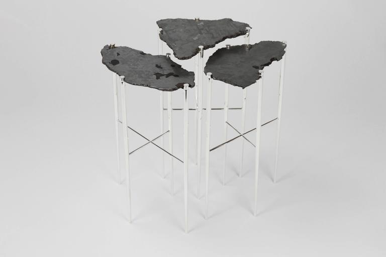 The Meteorite Cocktail tables are jewelry for the home.     Selected etched cross sections of a 5,000-year-old Meteorite, found in Argentina, are placed upon handcrafted sterling silver plated brass bases. The legs are individually turned, tapered,
