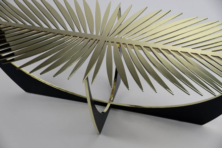 The double frond coffee table is made of solid brass.