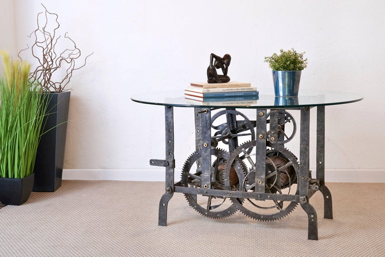 Beautiful coffee table designed from an authentic 18th century Italian tower turret clock mechanism. This mechanism was used for large clocks and bells you find up churches and public towers to keep time for the community. The mechanism is in forged