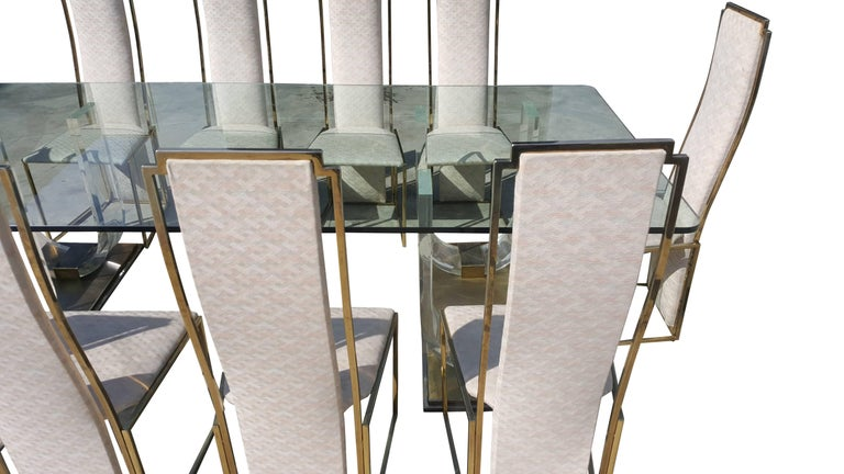 Amazing dining set with ten chairs in brass and a stunning table with a 2 cm thick quality glass.