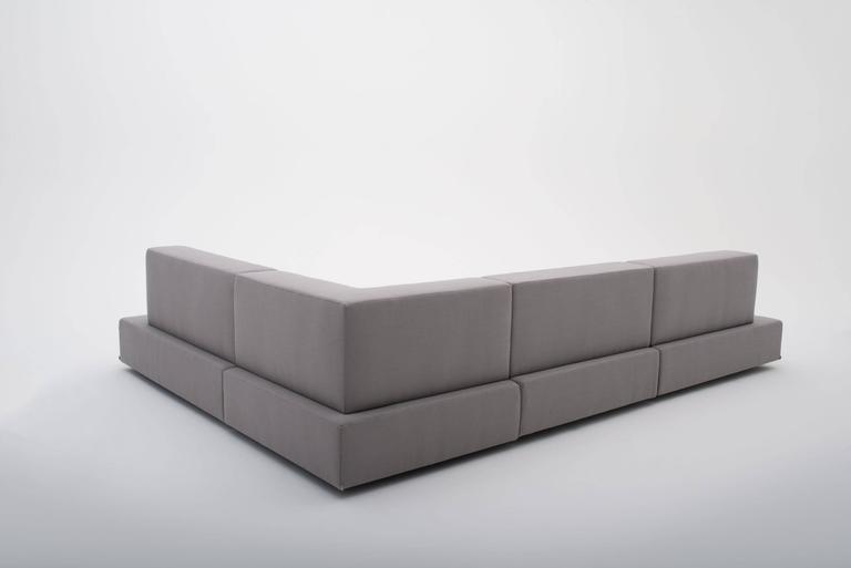 Wrapped in woven, wool blend, fabric the Dume sofa helps you achieve one of life's simplest pleasures, relaxing. Featuring a contrast button tuft, the Dume sofa's subtle details establish a sense of minimalism and elegance in your space. Upright,