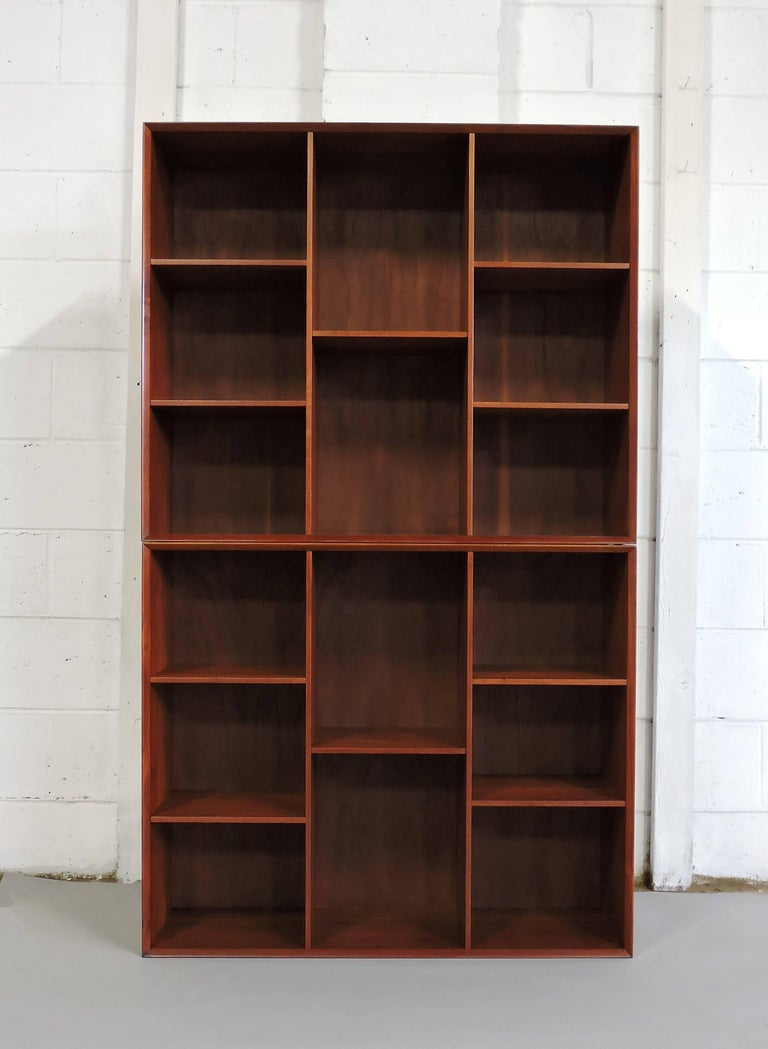 Handsome pair of bookcases designed by Peter Hvidt and Orla Mølgaard-Nielsen and manufactured in Denmark. These cabinets are made out of solid teak that has a beautiful grain and deep, rich color. Nice clean design and very well crafted with