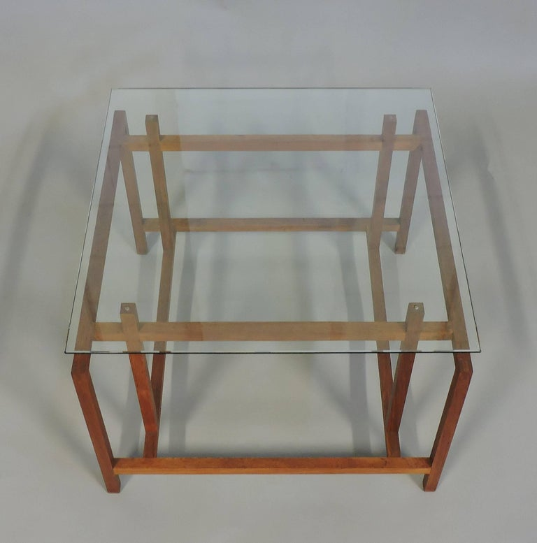 Handsome teak and glass Danish side table designed by Henning Norgaard and made in Denmark by Komfort Mobler. This excellently designed and solidly crafted table has a great architectural look and is made of solid teak with a new one-quarter inch