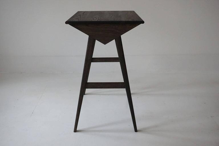 The Astral desk is designed for writing and computing. The sleek geometric base paired with the stoic character of the oak make it a desk for both the Futurist and the Naturalist. This duality is its strength as the desk is striking enough to bring
