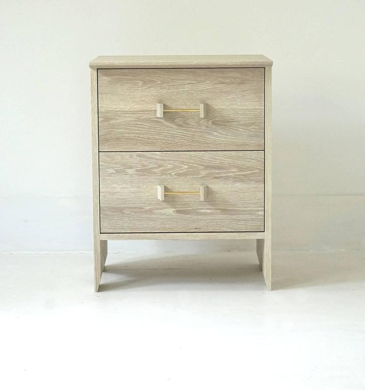 The Phoebe side cabinet offers convenient and versatile storage. It can be used as an end table, bed-side table or just as an additional storage piece in the living room or entryway. It is shown in bleached white oak and can be made to custom sizes