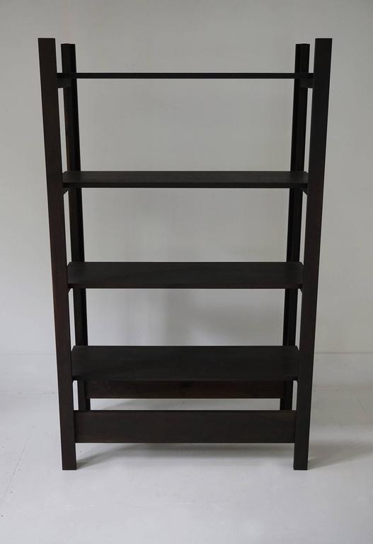 Upland shelving unit in oxidized walnut. Designed for display, books, and storage.