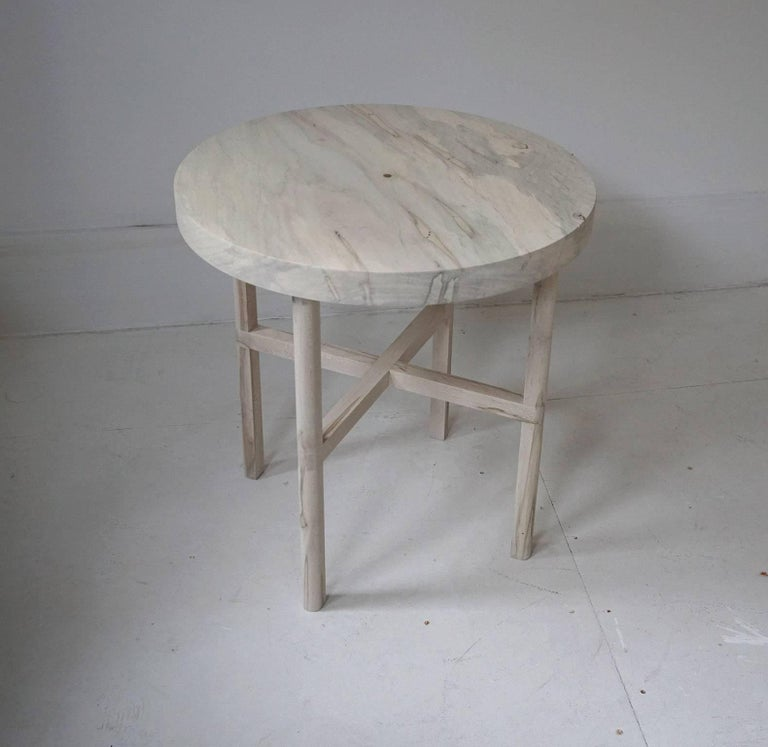 "Side table or end table in bleached ambrosia maple with brass detail. Measures: 19.25"", diameter x 20"" tall, 1.5"" thick top. Table pictured is currently in stock."