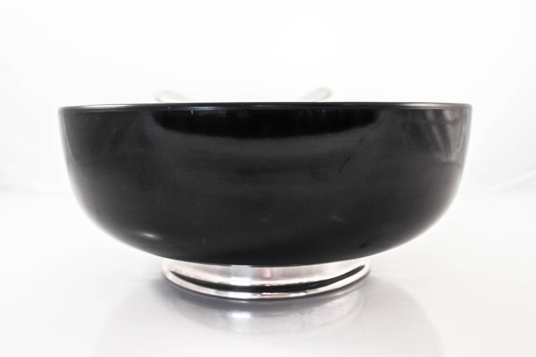 Beautiful sterling combined with one of the hardest plastic materials known produced this superb fruit, salad or dessert bowl set. Hot food such as vegetables, spaghetti, soups and chowders can be served more graciously and safely than porcelain or