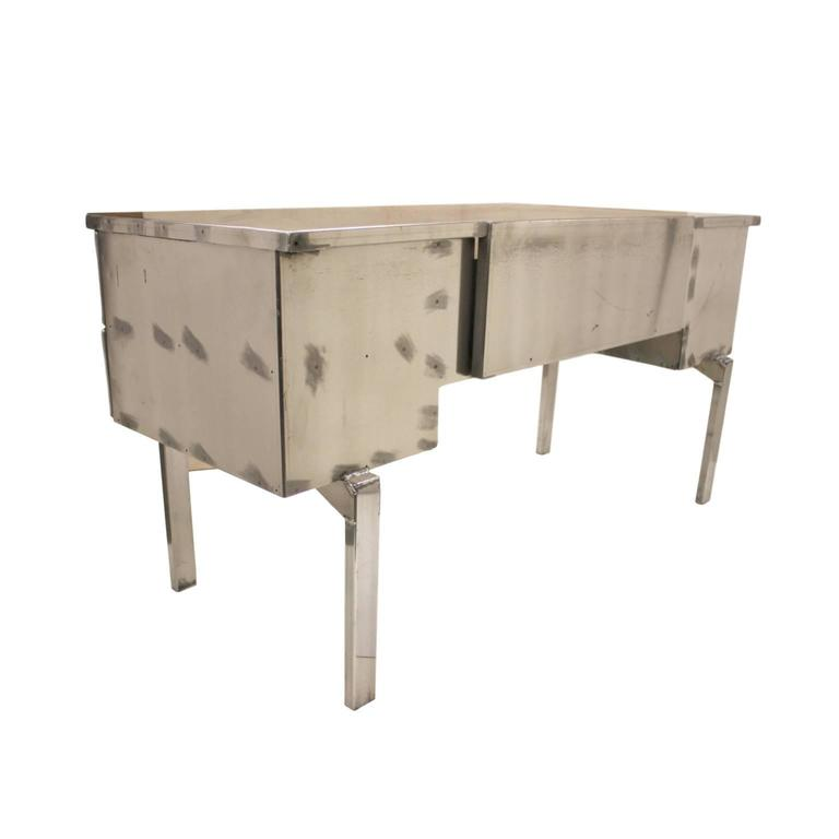 This desk was originally a medical field desk for the US military. Desk is completely constructed from aircraft-grade aluminium and features a very novel folding design that allowed it to be easily transported. We hand-stripped the outside of the