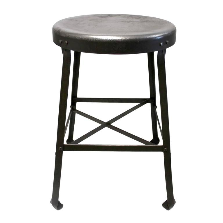This great little stool was made by the Angle Steel Stool company and was used in a Pharmacy Dept lab at Purdue University its whole life. Stool features a heavy-duty, riveted, bridge-like construction and a gorgeous 70+ year worn patina to the