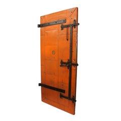 Vintage Orange Industrial Steel Plate Fire Door from 1915 Print Factory