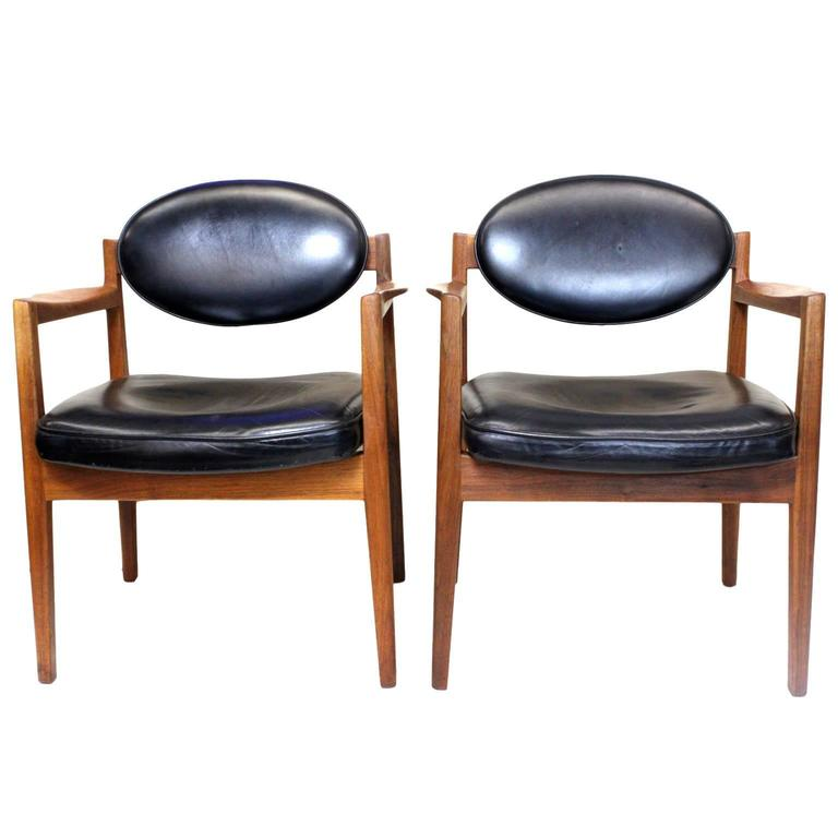 Pair Of Mid Century Modern Black Leather Oval Back