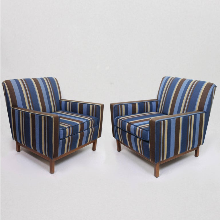 This wonderful set of matching vintage club chairs were manufactured by the famed Gunlocke Chair Company of Wayland, NY. Chairs feature a fantastic original wool upholstery with vibrant navy blue, sky blue, mocha brown, and tan stripes. Chair bases