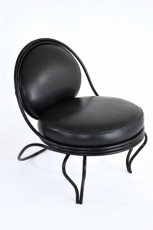 20th century vintage lounge chair by iconic french designer Mathieu Matégot named Copacabana composed of a curved tubular steel legs and structure. This particular edition is distinguishable through the rare design of the front feet.   The seat and