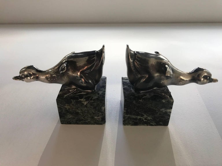 Collectible pair, typical of the Art Deco period, of book end by Rischmann composed of silvered bronze and a heavy green marble base. 