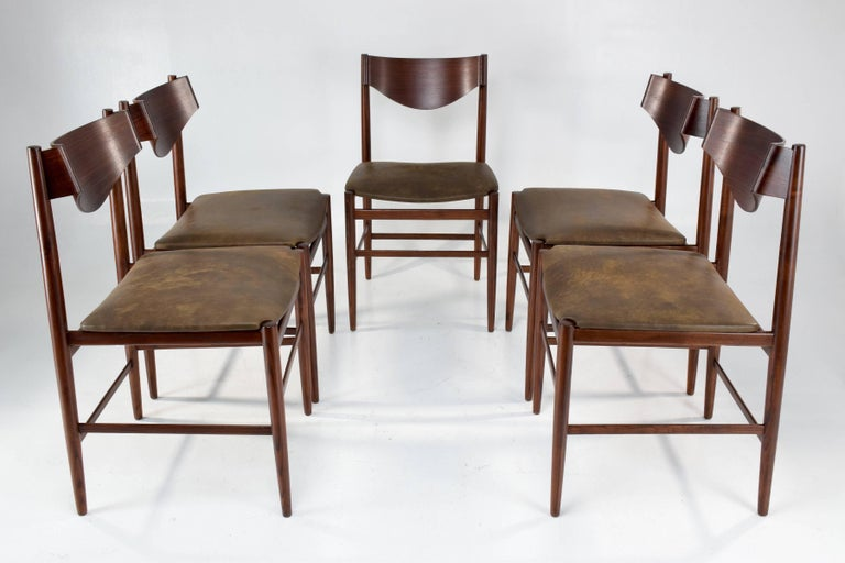 Set of five 20th century collectible vintage dining chairs by Italian designer Gianfranco Frattini for Cassina. Composed of re-finished mahogany and re-upholstered with a hight quality Italian patinated leather.  Iconic curved panels, very light