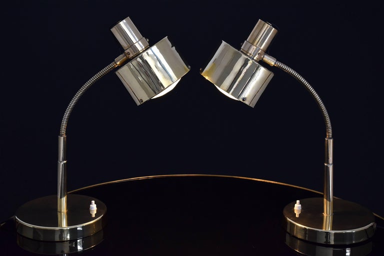 A pair of  20th century vintage fully restored desk or big table lamps composed of polished brass and faceted crystal shades in restored condition. Designed in Italy, circa 1960's.