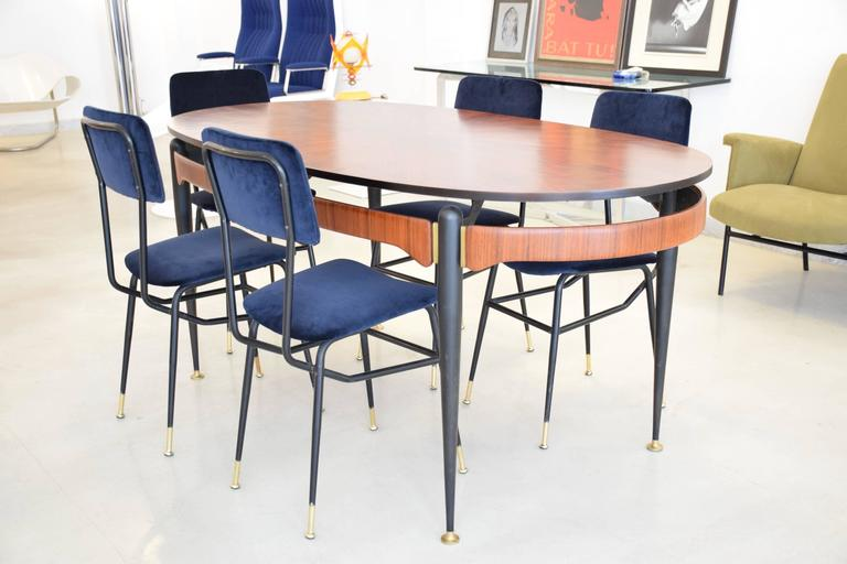 Set of six Italian 20th century vintage restored dining chairs by Studio BBPR designed with a graphic black lacquered steel structure and polished brass endings. Re-upholstered in a high quality Lelièvre Paris midnight blue velvet upholstery and new