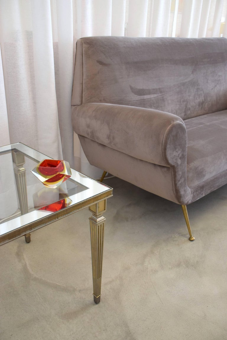 A 20th century vintage Maison Jansen coffee or side table in neoclassical style composed of a silver plated brass structure with fluted legs and intricate perforated details.  France, 1970's.