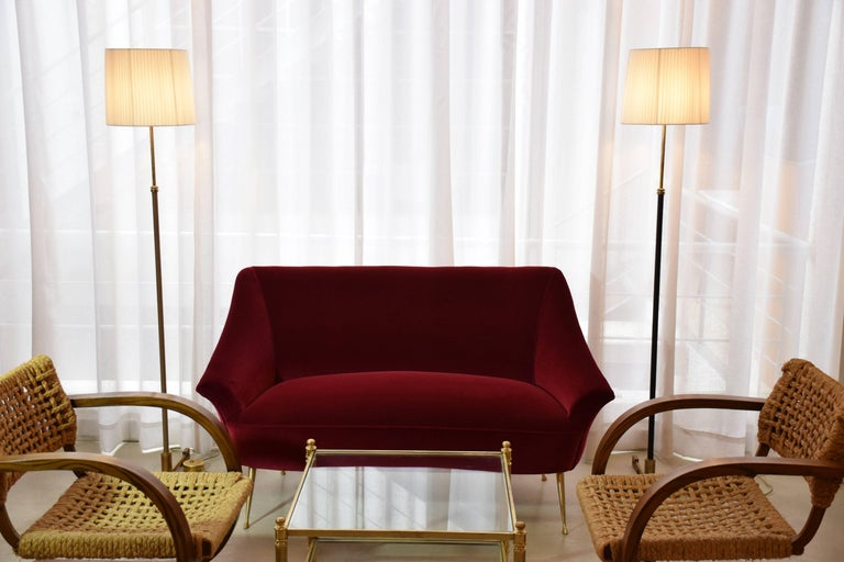 A vintage 20th century Italian polished brass-legged, curved two-seater design sofa in the style of Ico Parisi fully restored in red velvet by one of the highest quality French upholstery makers, Lelièvre Paris.  We have an armchair of similar style