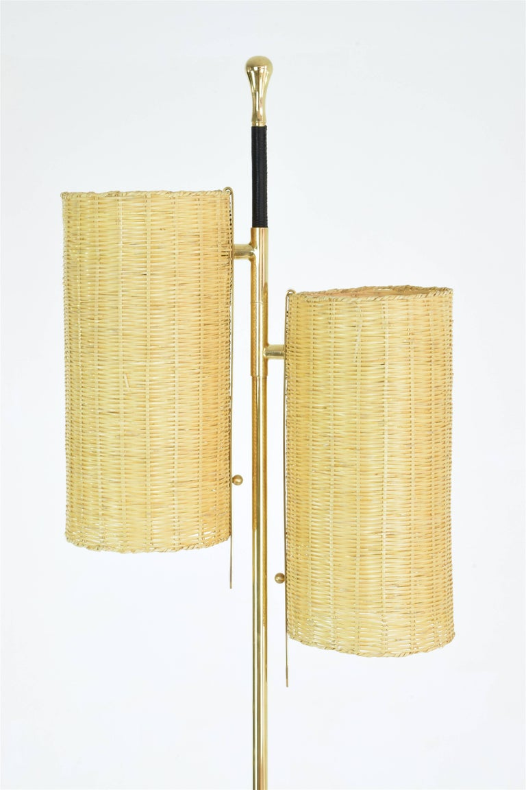 Equilibrium Definition: When oppposite forces are in total harmony   Contemporary handcrafted floor lamp composed of a thick solid brass structure, designed with two wicker shades, a black hand-plated leather detail and a Taznakht marble base. The