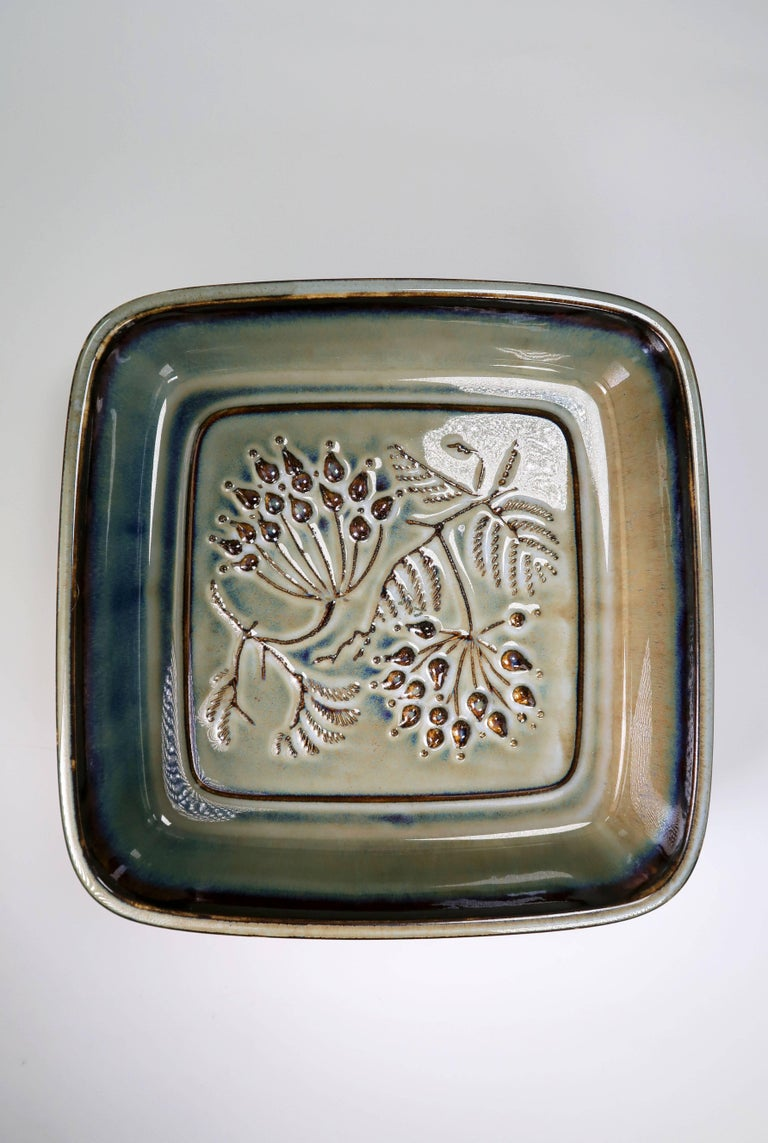 Danish Mid-Century Modern porcelain bowl by Danish Bing and Grondahl, later merged with Royal Copenhagen. Decorated with two stems with leaves and berries. Chestnut brown, olive green, sage and aqua blue colored glaze. Stamped on base. Model 7323.