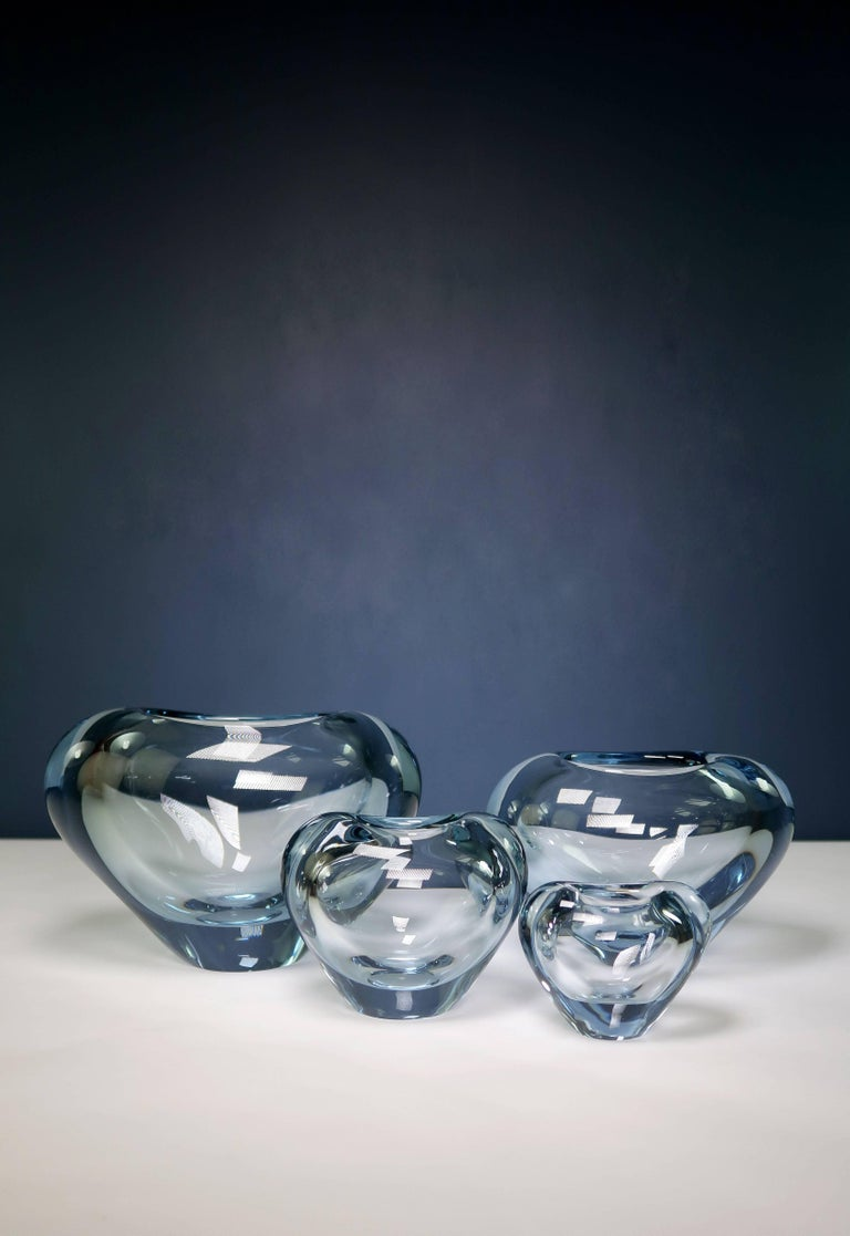 Four Danish Mid-Century Modern heart shaped vases in light blue hand blown art glass. All vases are intact and in beautiful and color-bright condition. By designer and artistic manager of Holmegaard Per Lütken (1916-1998). Manufactured in the
