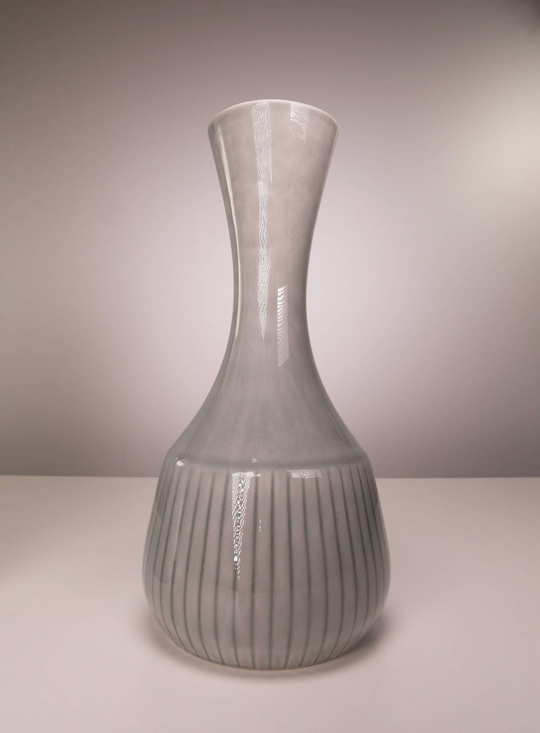 Rarely seen set of Mid-Century Scandinavian Modern smooth porcelain vases by acclaimed designer Gunnar Nylund for Rörstrand and Nordiska Kompaniet in Sweden.Light gray glaze with dark gray stripes on the belly. Stamped Rörstrand Sweden and NK