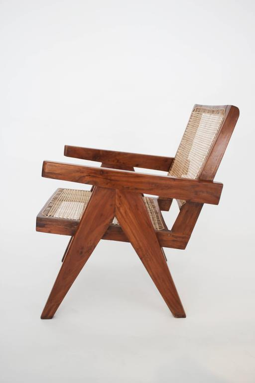 A pair of teak armchairs by Pierre Jeanneret for Chandigarh, circa 1950s. One of the chairs is a fraction longer than the other, a minor difference that does not affect the overall match. Measure: 70cm depth as opposed to 68cm depth of the second