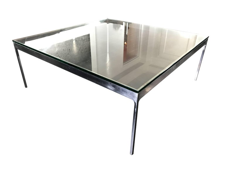 A large square stainless steel cocktail table by Nicos Zographos with thick 3/4