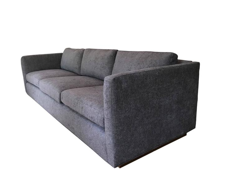 Stunning three-seat tuxedo Sofa designed by Milo Baughman for Thayer Coggin. Wood plinth base is raised on casters for a