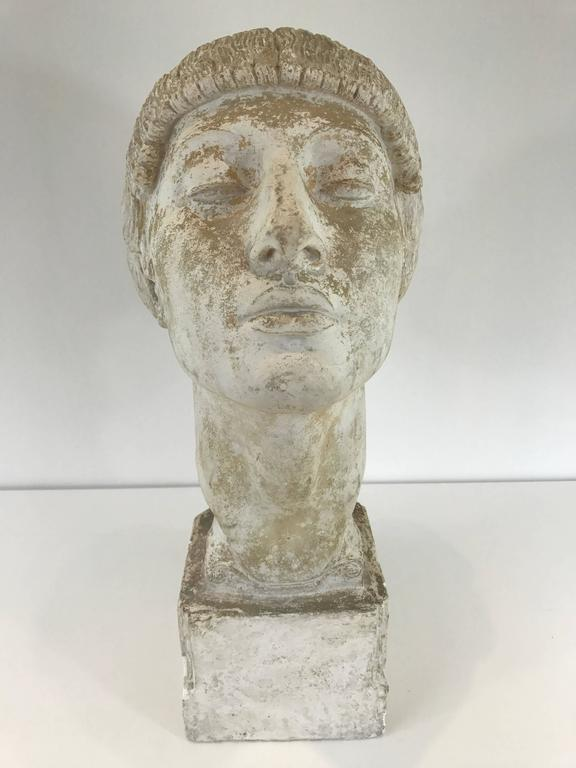 Art Deco plaster portrait bust of a woman. Strong expression with braided hair.