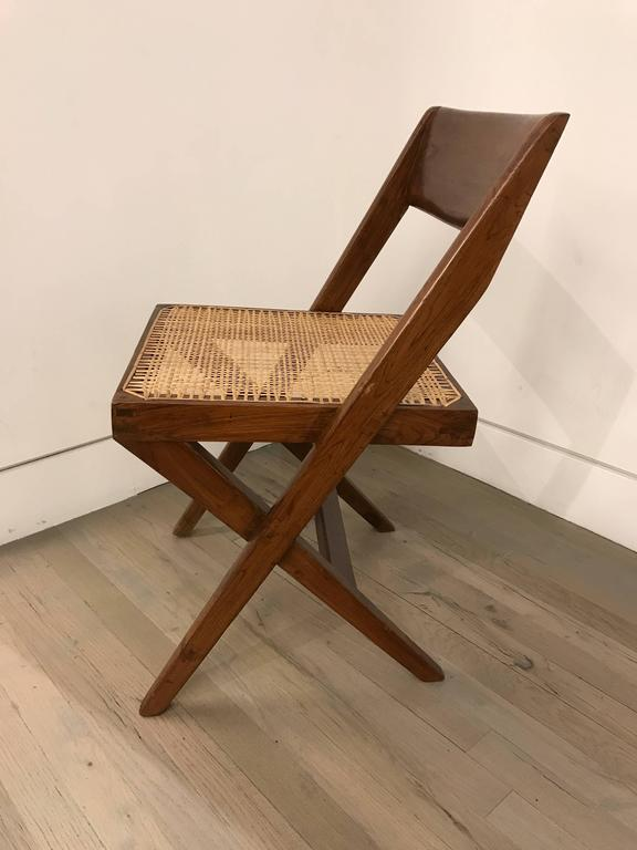 Mid-20th Century Set of Four Library Chairs by Pierre Jeanneret For Sale