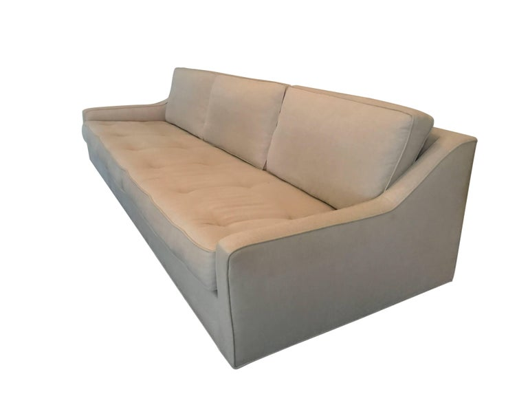 A sleek Danish modern linen upholstered sofa by Selig. Tapered legs and newly upholstered.