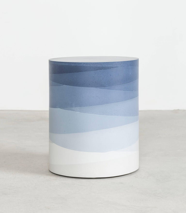 An exploration in the softness and subtly of the materials, the made-to-order drum has a hollow cavity and is cast entirely from hand-dyed cement. Poured in individual hand-dyed layers, starting from the top color indigo and fading to white, the