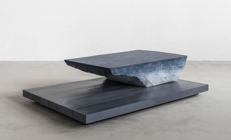 Composed in a language of landscape-oriented abstraction, the made-to-order coffee table is cast from hand-dyed sand and cement. The nuanced blue tones emulate the sky and the snow and the strong, sharp-edged base contrasts the natural textures.