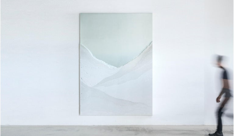 Through a layering of powdered glass, the mirror consists of gradient tones and textures suggesting landscape views of a rugged terrain. The hand-dyed granules are stratified with nuance and delicacy, coming together in a piece that is both useful