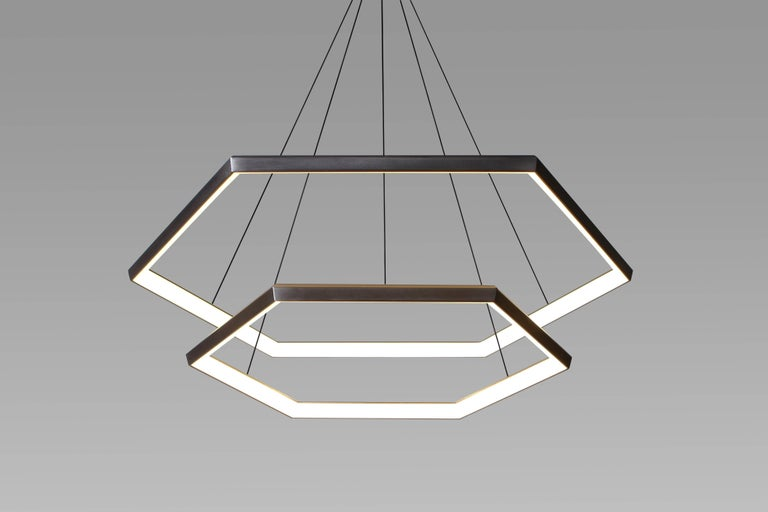 CascadeHX46 is a hexagonal light fixture from Studio Endo. Suspended effortlessly one above the other, delicate convex hexagonal forms create a sleek and modern chandelier.  The centerpiece of a room,Cascade descends from high ceilings in a