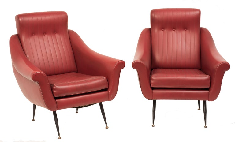 Pair of armchairs with padding upholstered with skai, structure in painted metal and extremities in brass.  Shipped from Italy. Under existing legislation, any item in Italy created over 70 years ago by an artist who has died requires a licence for