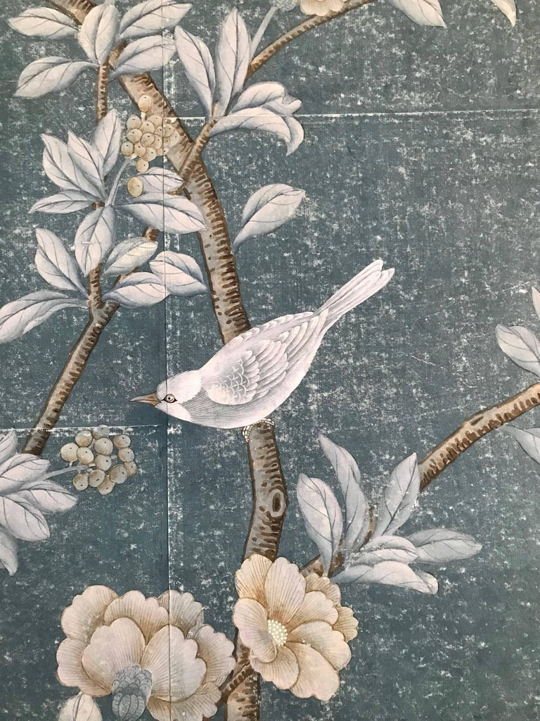 Gorgeous hand-painted chinoiserie panel of unknown manufacturer on paper with gilded bamboo frame.