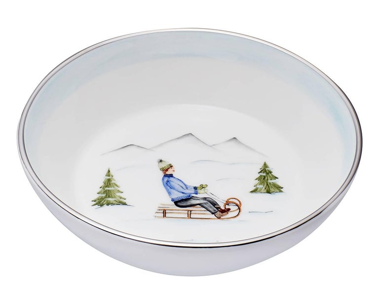 These completely handmade porcelain bowls painted with a charming hands-free winter decor come as a set of two designs. One shows a boy on a sladder and the other bowl is hands-free painted with a pair of ice skater. Rimmed with a 24 carat gold or