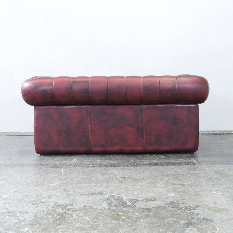 chesterfield designer leather sofa red two seat couch. Black Bedroom Furniture Sets. Home Design Ideas