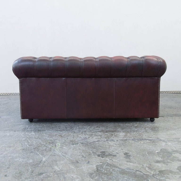 chesterfield leather sofa oxblood red two seat couch. Black Bedroom Furniture Sets. Home Design Ideas