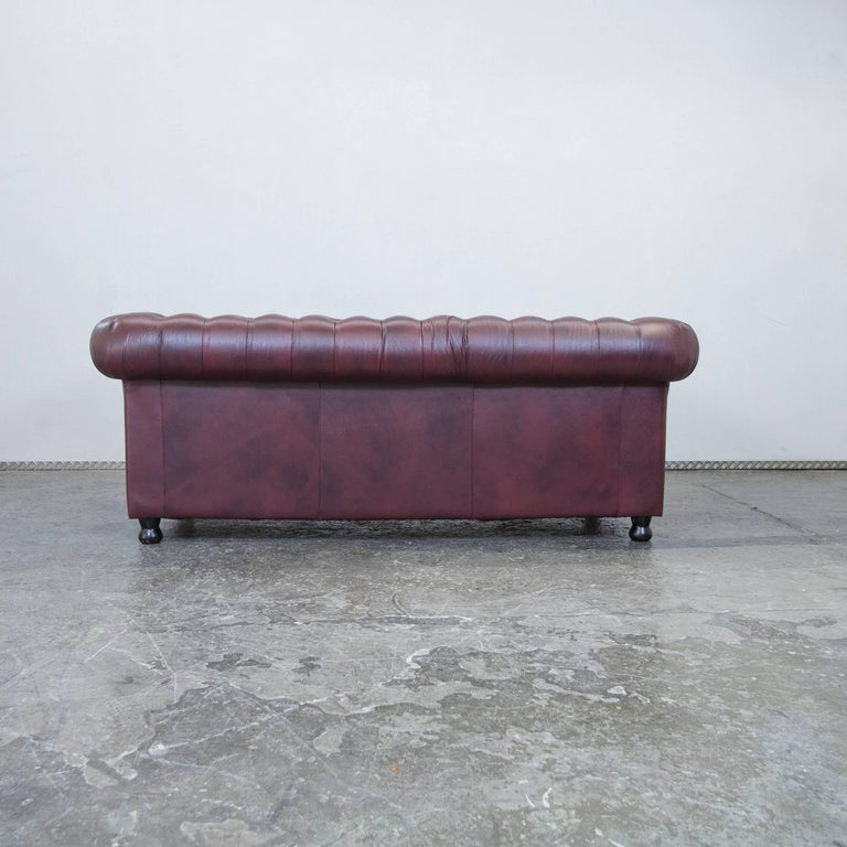 chesterfield leather sofa bordeaux red three seat couch. Black Bedroom Furniture Sets. Home Design Ideas