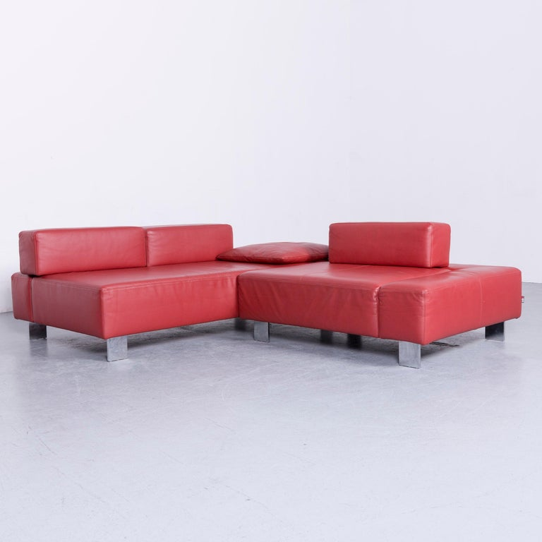 We bring to you an Brühl & Sippold fields designer sofa red leather corner sofa with function.