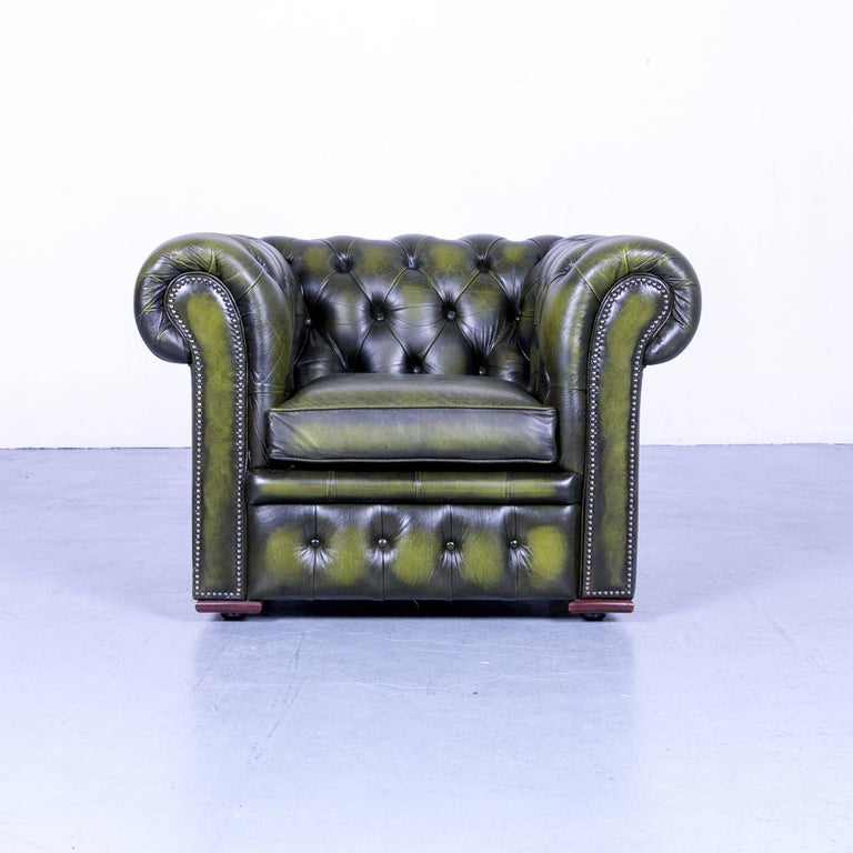 A vintage green Chesterfield leather buttoned clubchair.