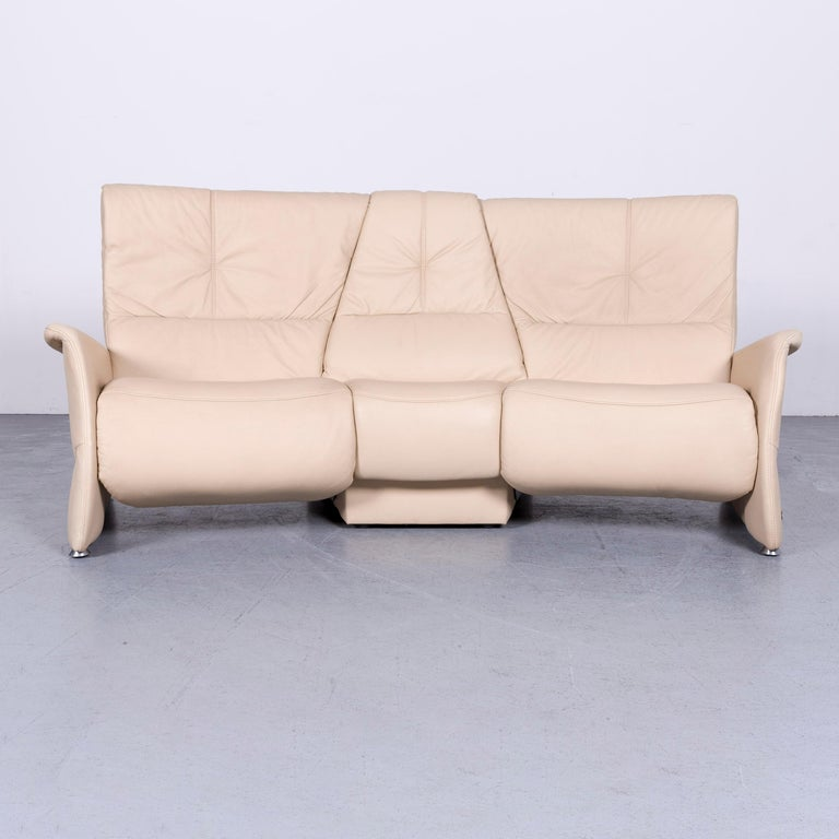 We bring to you a Himolla designer sofa beige three-seat couch recliner function.