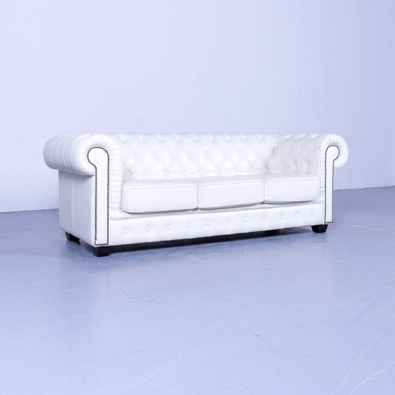 Chesterfield three-seat sofa white leather couch vintage retro rivets, made for pure comfort and elegance.